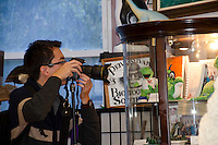 Winston Connorton photographing at the cryptozoology museum, Portland ME, USA