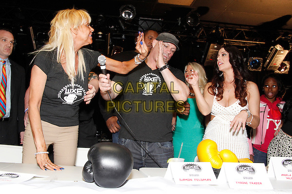WOODLYN, PA - APRIL 24 : Tan Mom and her opponent MILFMOM (Angela Cottone) got crazy at a press conference announcing their fight at The Venue Concert Hall in Woodlyn, Pa on April 24, 2014 <br /> CAP/MPI/SS<br /> &copy;SS/MPI/Capital Pictures