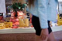 Diana Basfam, student at the International University of Monaco, walks by the Longchamp boutique in the Métropole Shopping Centre, Monte Carlo, Monaco, 19 April 2013