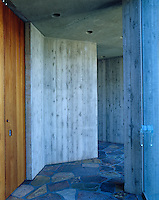One of the many passageways of the house made of contrasting materials