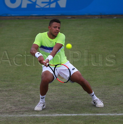 June 12th 2017,  Nottingham, England; WTA Aegon Nottingham Open Tennis Tournament day 3; 18 yr old Jay Clarke of Great Britain returns a serve from  Yuki Bhambri of India