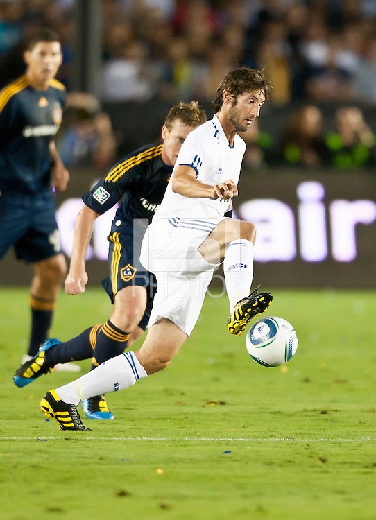 Real midfielder Esteban Granero (11) moves the ball up the pitch during the first half of the friendly game between LA Galaxy and Real Madrid at the Rose Bowl in Pasadena, CA, on August 7, 2010. LA Galaxy 2, Real Madrid 3.