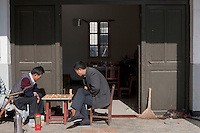 Villagers play Chinese chess game in Zhouzhuang Town of Jiangsu Province, China on November 18, 2008. Zhouzhuang, one of the most famous water townships in China, is noted for its profound cultural background, the well preserved ancient residential houses, the elegant watery views and the colourful local traditions and folklore. Sixty percent of the Zhouzhuang's structures were built during the Ming and Qing Dynasties from 1368 to 1911.