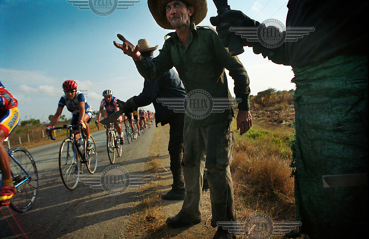 Campesinos cheering on cyclists in the Vuelta a Cuba (the Tour of Cuba cycling race).