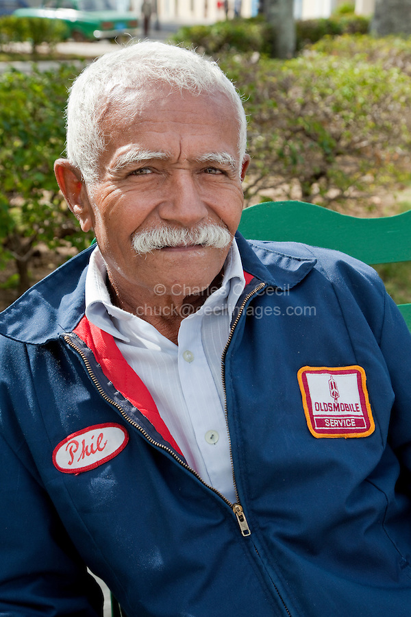 Cuba, Cienfuegos.  Old Man, wearing Used Jacket of Oldsmobile Employee.