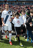30 March 2013: Los Angeles Galaxy defender Todd Dunivant #2 with a player escort leads the LA Galaxy onto the pitch during the opening ceremonies in an MLS game between the LA Galaxy and Toronto FC at BMO Field in Toronto, Ontario Canada..The game ended in a 2-2 draw..
