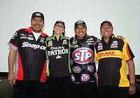 Jun. 1, 2012; Englishtown, NJ, USA: NHRA funny car drivers (L-R) Cruz Pedregon, Alexis DeJoria, Tony Pedregon and Jeff Arend during qualifying for the Supernationals at Raceway Park. Mandatory Credit: Mark J. Rebilas-