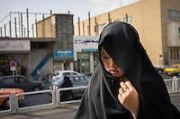 June 11, 2014 - Qom, Iran. A girl walks in the holy city of Qom, in central Iran. © Thomas Cristofoletti / Ruom
