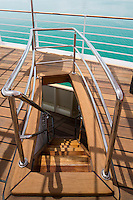 Narrow wooden staircases with 1930s style chrome handrails connect the various sun decks.  The original decking was stripped and re-laid in a combination of ipe and iroko wood
