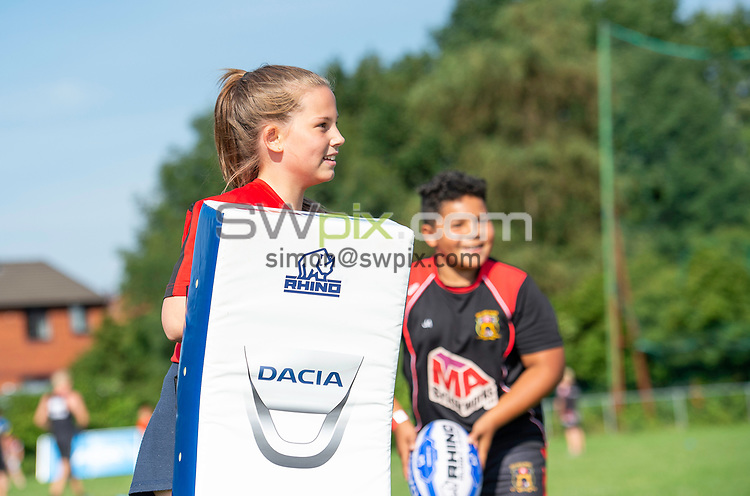 Picture by Allan McKenzie/SWpix.com - 25/07/2018 - Rugby League - Dacia Flair Play - New Spring Lions & Ince Rose Bridge RLFC, Ince-in-Makerfield, England - New Spring Lions & Ince Rose Bridge girls given training, Dacia, branding.