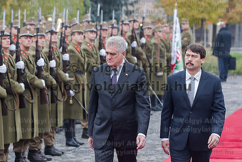 Tomislav Nikolic (L) president of Serbia and his Hungarian counterpart Janos Ader (R) inspect the guard of honor during a welcoming ceremony in Budapest, Hungary on November 13, 2012. ATTILA VOLGYI