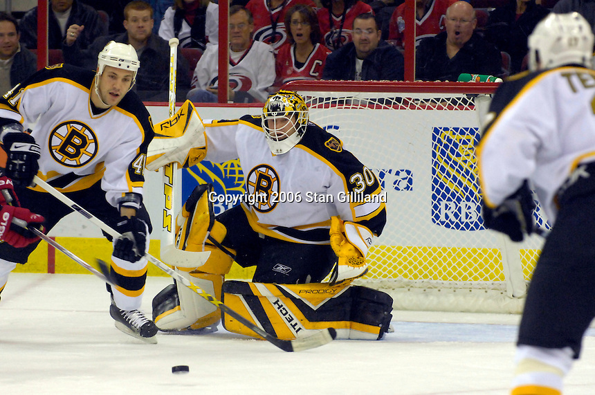 Boston Bruins' goalie Tim Thomas makes a pad save helped by teammate Andrew Alberts (41) during an NHL hockey game against the Carolina Hurricanes Saturday, Dec. 2, 2006 in Raleigh, N.C. Carolina won 5-2.<br />