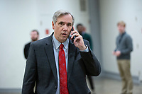 United States Senator Jeff Merkley (Democrat of Oregon) walks through the Senate Subway during a cloture vote on a Coronavirus Stimulus Package at the United States Capitol in Washington D.C., U.S., on Monday, March 23, 2020.  Credit: Stefani Reynolds / CNP/AdMedia