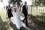 Michael Gisick and Megan Bainbridge leave church after getting married in Queenscliff, Australia. Nov. 16, 2012.