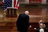 Former Sen. Alan Simpson, R-Wyo, center, speaks with former President George Bush, right, as he walks to a podium to speak during the State Funeral for former President George H.W. Bush at the National Cathedral, Wednesday, Dec. 5, 2018, in Washington. <br /> CAP/MPI/RS<br /> &copy;RS/MPI/Capital Pictures