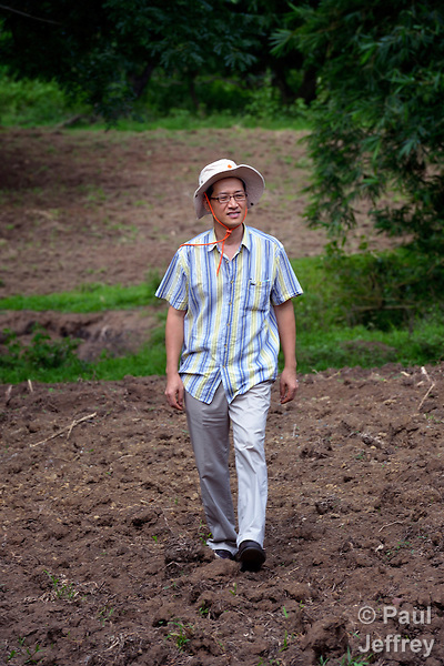 The Rev. Jae Hyoung Choi is a United Methodist missionary serving in the Philippines, where he teaches at Union Theological Seminary in Cavite. Born in Korea, Choi's work with the seminary's Center for Geocentric Ministries focuses on the interrelationship between land, justice and ecology. Here he walks on a farm belonging to the seminary.