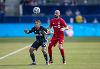 """CARSON, CA - FEBRUARY 15: Javier """"Chicharito"""" Hernandez #14 of the Los Angeles Galaxy heads a ball past Laurant Ciman #26 of Toronto FC during a game between Toronto FC and Los Angeles Galaxy at Dignity Health Sports Park on February 15, 2020 in Carson, California."""