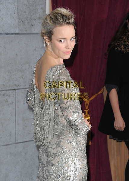 Rachel McAdams.The World Premiere of 'Sherlock Holmes: A Game of Shadows' held at The Village Theatre in Brentwood, California, USA..December 6th, 2011.half length dress silver beads beaded dress hand on hip backless draped cowl looking over shoulder .CAP/RKE/DVS.©DVS/RockinExposures/Capital Pictures.