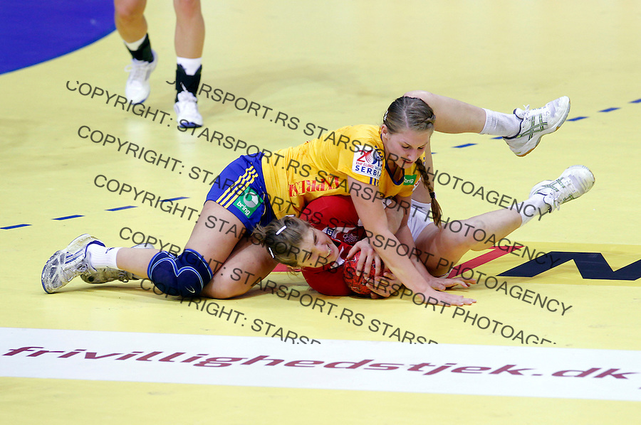 NIS, SERBIA 4/12/2012/ Linn Blohm of Sweden (top) fights for the ball during Women`s European Handball Championship match between Sweden and Denmark in Cair arena in city of Nis in southern Serbia on  December 4, 2012 Credit: PEDJA MILOSAVLJEVIC/SIPA/