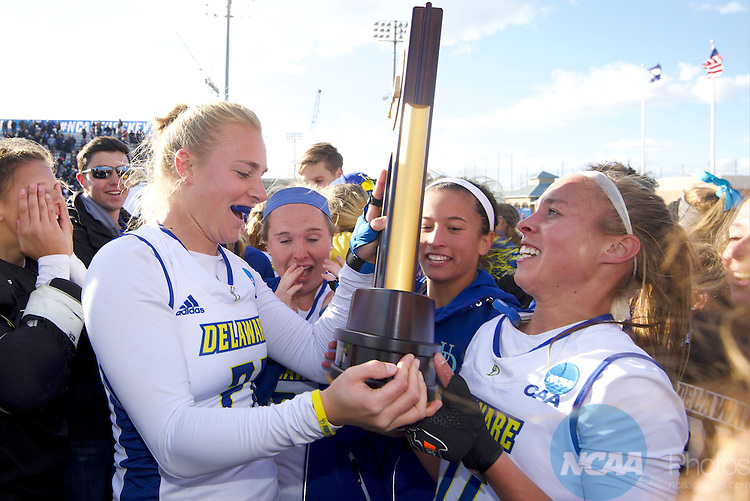 NORFOLK, VA - NOVEMBER 20:  Lisa Giezeman (11) and Greta Nauck (21) of the University of Delaware celebrate their victory over the University of North Carolina during the Division I Women's Field Hockey Championship held at the LR Hill Sports Complex on November 20, 2016 in Norfolk, Virginia.  Delaware defeated North Carolina 3-2 for the national title. (Photo by Jamie Schwaberow/NCAA Photos via Getty Images)