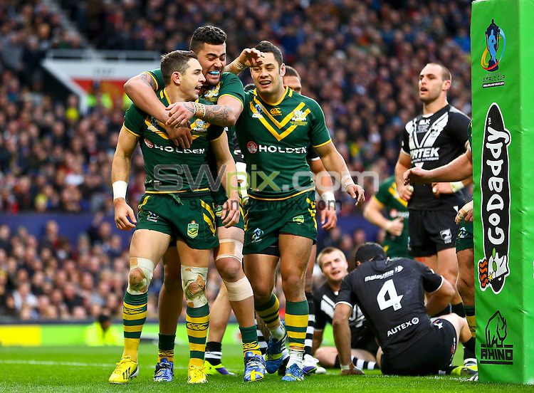 Picture by Alex Whitehead/SWpix.com - 30/11/2013 - Rugby League - Rugby League World Cup Final - New Zealand v Australia - Old Trafford, Manchester, England - Australia's Billy Slater (L) celebrates his try with Andrew Fifita (centre) and Jarryd Hayne (R).