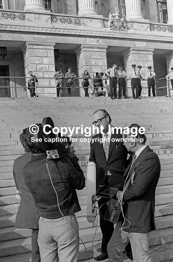 N Ireland Assembly - first meeting of the newly-elected members - 31st July 1973 - SDLP leader Gerry Fitt is interviewed by a television crew on the steps of Parliament Buildings, Stormont, Belfast, N Ireland, 197307310523b<br /> <br /> Copyright Image from Victor Patterson,<br /> 54 Dorchester Park, <br /> Belfast, UK, BT9 6RJ<br /> <br /> t1: +44 28 9066 1296 (from Rep of Ireland 048 9066 1296)<br /> t2: +44 28 9002 2446 (from Rep of Ireland 048 9002 2446)<br /> <br /> m: +44 7802 353836<br /> <br /> e: victorpatterson@me.com<br /> www.victorpatterson.com<br /> <br /> Please see my Terms and Conditions of Use at www.victorpatterson.com. It is IMPORTANT that you familiarise yourself with them.<br /> <br /> Images used on the Internet must be visibly watermarked i.e. &copy; Victor Patterson<br /> within the body of the image and copyright metadata must not be deleted. Images <br /> used on the Internet have a size restriction of 4kbs and will be chargeable at current<br />  NUJ rates unless agreed otherwise.<br /> <br /> This image is only available for the use of the download recipient i.e. television station, newspaper, magazine, book publisher, etc, and must not be passed on to any third <br /> party. It is also downloaded on condition that each and every usage is notified within 7 days to victorpatterson@me.com<br /> <br /> The right of Victor Patterson to be identified as the author is asserted in accordance with The Copyright Designs And Patents Act (1988). All moral rights are asserted.