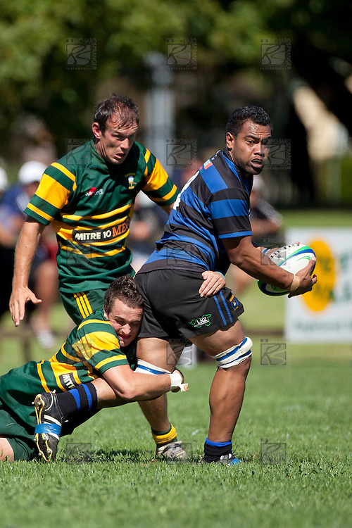 Edwin Faumaile looks for support as he gets tackled by James Semple. Counties Manukau Club Rugby game between Pukekohe and Onewhero played at Colin Lawrie Fields Pukekohe on Saturday 19th March 2011..Pukekohe won 37 - 8.