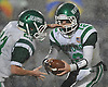 Seaford quarterback No. 12 Andrew Cain, right, hands off to No. 23 Danny Roell during the Nassau County varsity football Conference IV final against Locust Valley at Hofstra University on Thursday, Nov. 19, 2015. Locust Valley won by a score of 20-6.<br /> <br /> James Escher