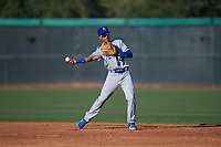 AZL Royals shortstop Enrique Valdez (4) throws to first base during an Arizona League game against the AZL White Sox at Camelback Ranch on June 19, 2019 in Glendale, Arizona. AZL White Sox defeated AZL Royals 4-2. (Zachary Lucy/Four Seam Images)