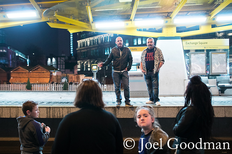 """© Joel Goodman - 07973 332324 . 16/12/2016 . Manchester , UK . Exchange Square tram stop . Revellers out in Manchester City Centre overnight during """" Mad Friday """" , named for being one of the busiest nights of the year for the emergency services in the UK . Photo credit : Joel Goodman"""