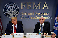 United States President Donald J. Trump speaks during a teleconference with governors at the Federal Emergency Management Agency headquarters, Thursday, March 19, 2020, in Washington, DC. US Vice President Mike Pence is at right. <br /> Credit: Evan Vucci / Pool via CNP/AdMedia