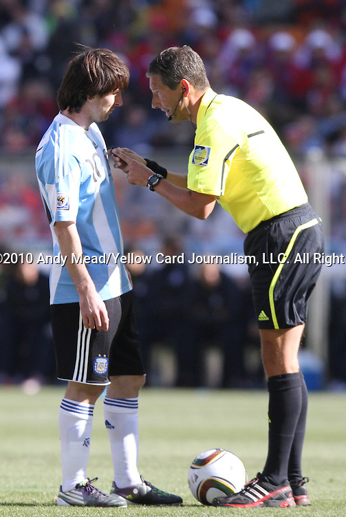 17 JUN 2010: Referee Frank de Bleeckere (BEL) instructs Lionel Messi (ARG) (left) to wait until he whistles before playing the ball. The Argentina National Team defeated the South Korea National Team 4-1 at Soccer City Stadium in Johannesburg, South Africa in a 2010 FIFA World Cup Group E match.