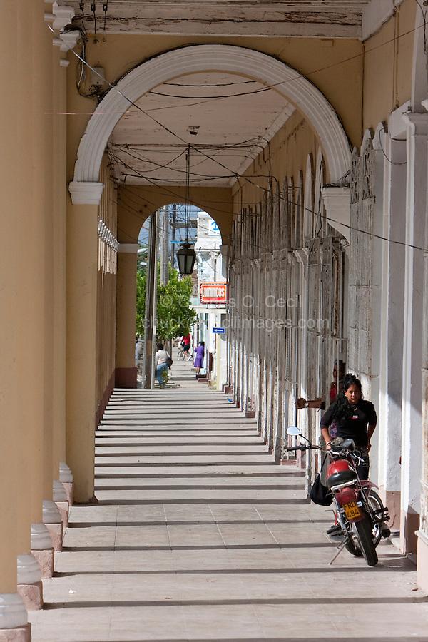 Cuba, Cienfuegos.  Arcade on Avenida 56, opposite Parque Marti.