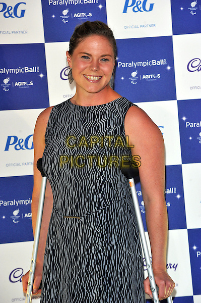 Stephanie Dixon.The Paralympic Ball in aid of the British Paralympic Association & the Agitos Foundation, Grosvenor House Hotel, Park Lane, London, England..September 5th, 2012.half length black white patten sleeveless dress crutches.CAP/CJ.©Chris Joseph/Capital Pictures.
