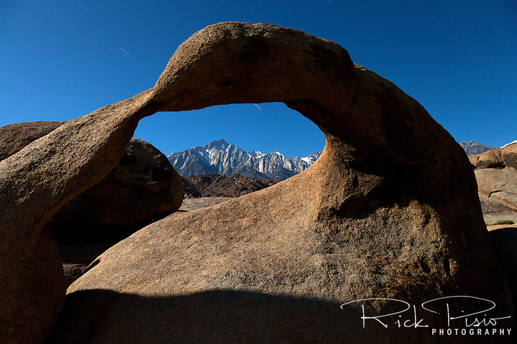 "Mobius Arch, in California's Alabama Hills State Recreation Area forms a portal to view  Lone Pine Peak. Since the 1920's film makers have been using the Alabama Hills as a backdrop for their movies. In the early days of motion pictures films such as ""Gunga Din"", ""How the West Was Won"", and ""Yellow Sky"" were filmed at a site within the recreation area known as ""Movie Flats. More recently movies such as ""Tremors"", ""Star Trek Generations,"" ""Gladiator"", ""Iron Man"", and ""Django Unchained"" were shot in the Alabama Hills."