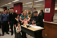 One month after Washington State voters approved the state's marriage equality law in Ref. 74, couples lined up to get marriage licenses on December 6th, 2012. Shortly after midnight, Amanda Beane and Anne Bryson-Beane, of Seattle, were granted their license by King County Executive Dow Constantine. The couple have adopted 7 children, of whom helps hold up their newly aquired license as one scurries back to her brothers and sisters. Amanda and Anne have been together 15 years. ..Anne: ?Each of our adopted children understands that you can call someone family all you want, but until the court says it's forever, you are not seen as a 'real' family. When I marry my wife, for the first time our family will be seen by everyone for what we are - a forever family.? Amanda: ?One of my most difficult experiences as a parent has been watching our seven children learn that their parents are not legally married, only because we were not allowed to be. Our marriage shows our children that Washington values and protects our family the same as other families, and I am so grateful that we can provide them that security.? ..The adoption agency Amara produced a video (?Seven Children Find a Permanent Home?) that tells the family story. See www.youtube.com/watch?v=ucUktPm9ZUE.