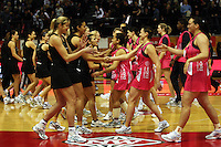 The teams join together before the match during the International  Netball Series match between the NZ Silver Ferns and World 7 at TSB Bank Arena, Wellington, New Zealand on Monday, 24 August 2009. Photo: Dave Lintott / lintottphoto.co.nz