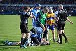 Barry Coughlan of Waterford is treated for an injury during their National League game against Clare at Cusack Park. Photograph by John Kelly.