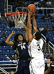 Nevada's AJ West (3) dunks over Utah State defender Jalen Moore (14) during an NCAA college basketball game in Reno, Nev., on Tuesday, Jan. 20, 2015. Utah State won 70-54. (AP Photo/Cathleen Allison)