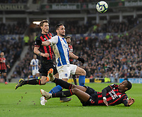 Brighton & Hove Albion's Florin Andone (left) is tackled by Huddersfield Town's Terence Kongolo (right) just before Florin Andone headers the ball to scores his side's first goal  <br /> <br /> Photographer David Horton/CameraSport<br /> <br /> The Premier League - Brighton and Hove Albion v Huddersfield Town - Saturday 2nd March 2019 - The Amex Stadium - Brighton<br /> <br /> World Copyright © 2019 CameraSport. All rights reserved. 43 Linden Ave. Countesthorpe. Leicester. England. LE8 5PG - Tel: +44 (0) 116 277 4147 - admin@camerasport.com - www.camerasport.com