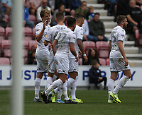 Leeds United's Patrick Bamford (left) celebrates scoring the opening goal <br /> <br /> Photographer Stephen White/CameraSport<br /> <br /> The EFL Sky Bet Championship - Wigan Athletic v Leeds United - Saturday 17th August 2019 - DW Stadium - Wigan<br /> <br /> World Copyright © 2019 CameraSport. All rights reserved. 43 Linden Ave. Countesthorpe. Leicester. England. LE8 5PG - Tel: +44 (0) 116 277 4147 - admin@camerasport.com - www.camerasport.com
