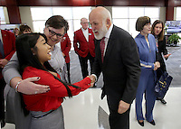 NWA Democrat-Gazette/DAVID GOTTSCHALK   Yulissa (cq) Rivera, a sophomore and student council president at Don Tyson School of Innovation, receives a hug Thursday, February 9, 2017, from Cindy Lyons, a math teacher, as they meet John Tyson, chairman of the board for Tyson Foods, during a dedication ceremony for Springdale's new Don Tyson School of Innovation campus. The school is named after Donald Tyson former chairman and chief executive officer of Tyson Foods. Half of the campus opened in August, with construction wrapping up on the other half in time for this semester.