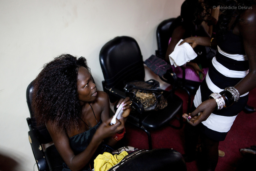 """4 december 2010 - Juba, Southern Sudan - Contestants getting ready to participate in Miss Malaika South Sudan 2010 at Nyakuron Cultural Centre Juba. The contest featured 15 women from all 10 of South Sudan's states. The event was a way to show off their talents, traditions and culture. The competition was originally put together in 2005 by the southern Sudanese diaspora living in neighbouring Kenya. The word """"Malaika"""" means angel in Kiswahili, spoken widely in Kenya, the country where tens of thousands of southerners fled to, during ongoing conflicts. photo credit: Benedicte Desrus"""