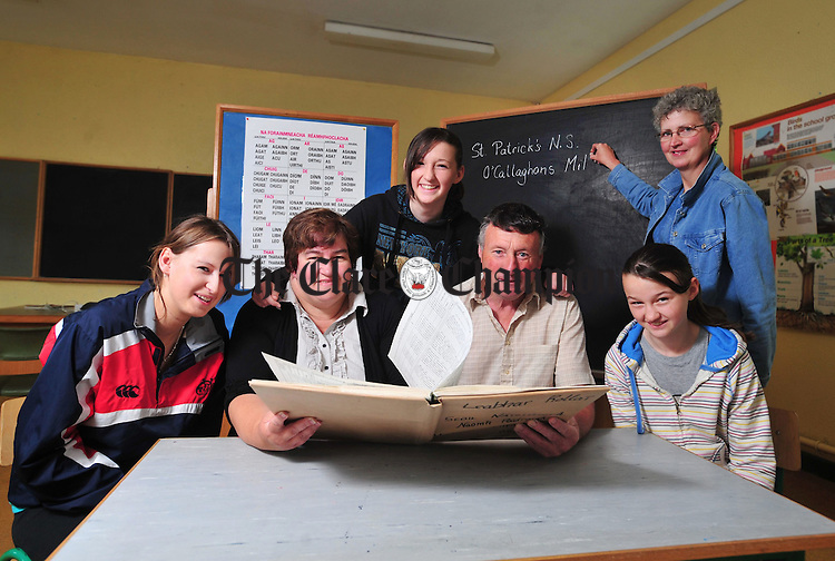 Frank and Geraldine Mc Namara look through the school register with their daughters Louise, Pauline and Edel and Phil Ryan, acting principal, who taught all five children. Photograph by Declan Monaghan