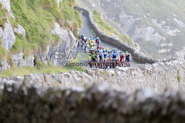 Picture by Alex Whitehead/SWpix.com - 08/09/2014 - Cycling - 2014 Friends Life Tour of Britain - Stage 2, Knowsley to Llandudno - Omega Pharma Quick-Step's Michal Kwiatkowski leads the peloton on the Great Orme near the finish of Stage 2 in Llandudno.