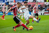 James Ward-Prowse of Southampton  and Neil Taylor of Swansea City  in action during the Barclays Premier League match between Swansea City and Southampton  played at the Liberty Stadium, Swansea  on February 13th 2016