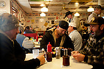 Kendrick Brinson.LUCEO..Tim Cryer (left), 46, and Ron Scheck (center), 43, drink coffee with a friend of the often full Lonnie's Roadhouse, a diner alongside Highway 2 in Williston, North Dakota, January 2012. Williston is currently experiencing an influx of people relocating there for the town's third oil boom...Model Released: yes.Assigning Editor: Michael Wichita.