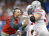 Ohio State Buckeyes head coach Urban Meyer tries to fire up his team after a touchdown against Alabama Crimson Tide during the 3rd quarter of the Allstate Sugar Bowl college football Playoff Semifinal game at the Mercedes-Benz Superdome in New Orleans, Louisiana on January 1, 2015.  (Dispatch photo by Kyle Robertson)