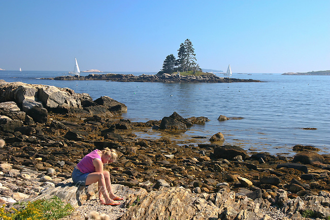 Girl playing on the coast of Maine.