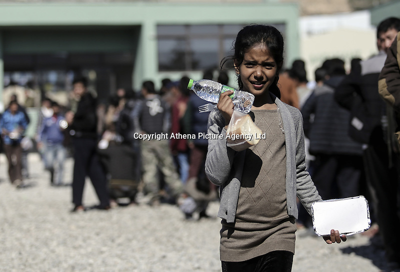 Pictured: A young girl having just been given food Friday 26 February 2016<br /> Re: Hundreds of refugees have been given temporary shelter at the Stefanakis Army Camp in the Schisto area of Athens, Greece.
